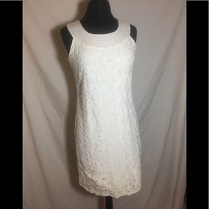White lace layered over cotton sleeveless dress